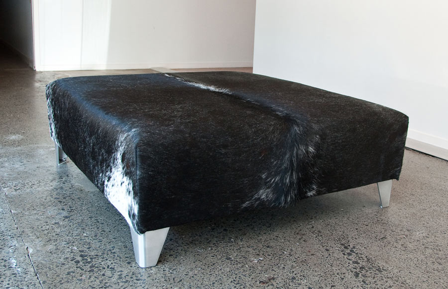 Picture of: stunning black leather ottoman
