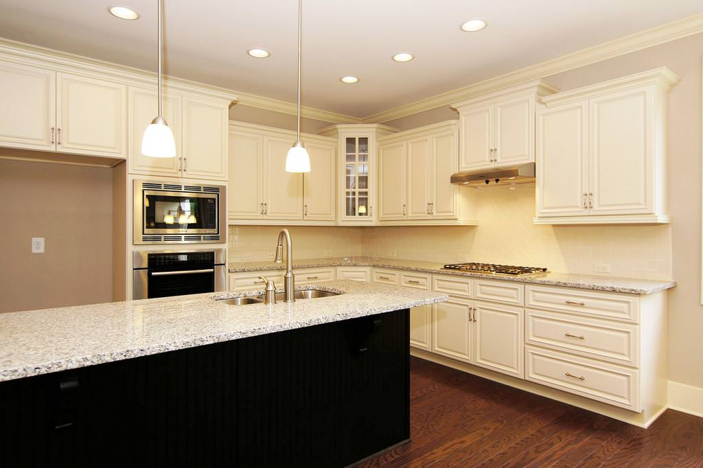 Image of: Luna Pearl Granite Countertops White Cabinets