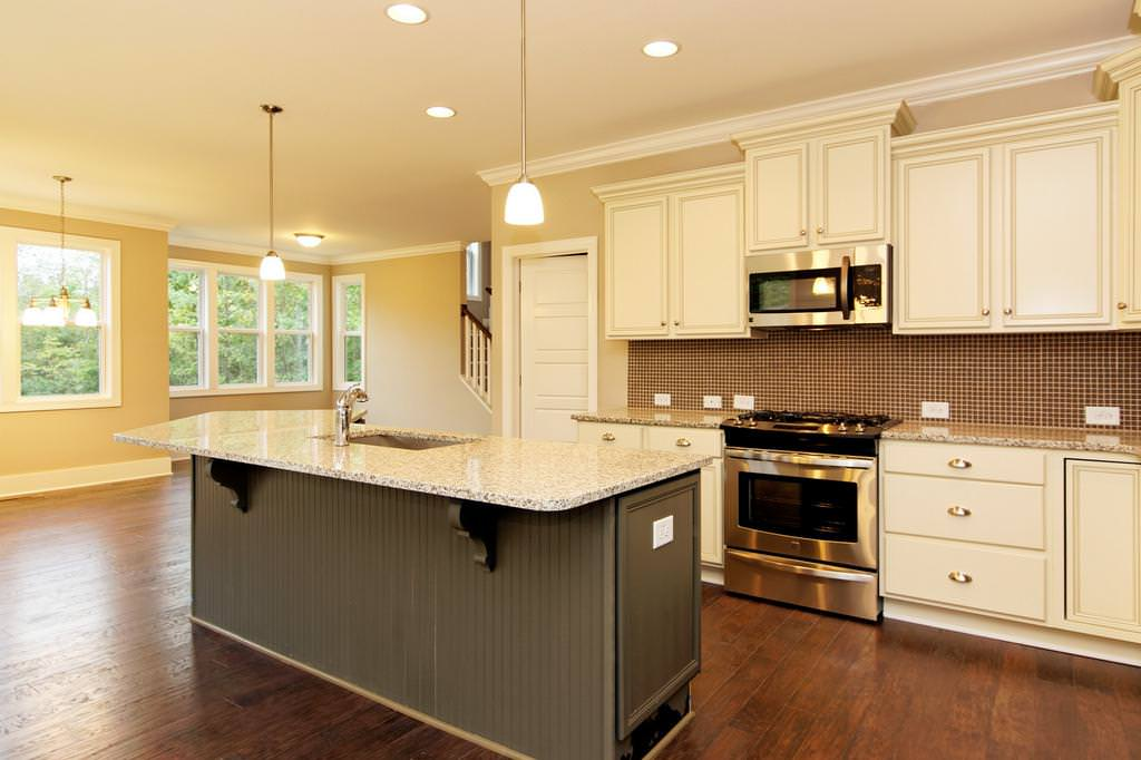 Image of: Luna Pearl Granite With Dark Cabinets