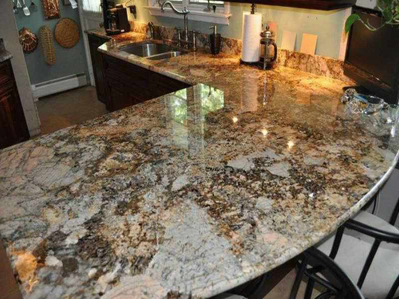 Picture of: Solarius Granite And Backsplash