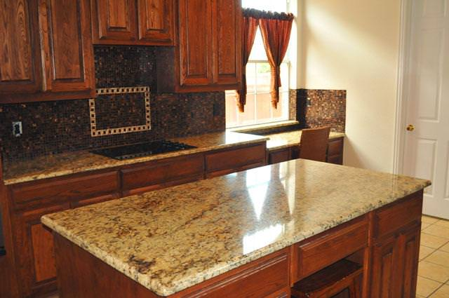 Image of: Santa Cecilia Granite With Cherry Cabinets