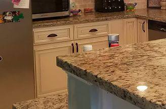 Image of: Santa Cecilia Granite With White Cabinets