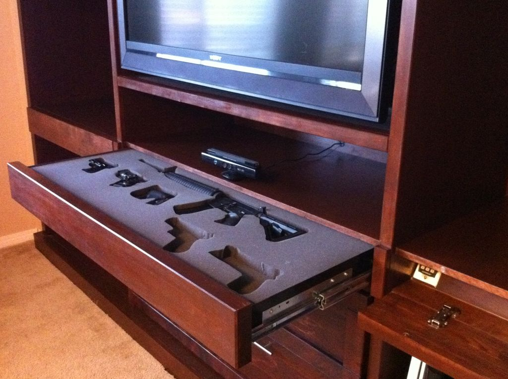 Picture of: hidden gun cabinet pictures