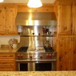eclectic kitchen knotty alder cabinets