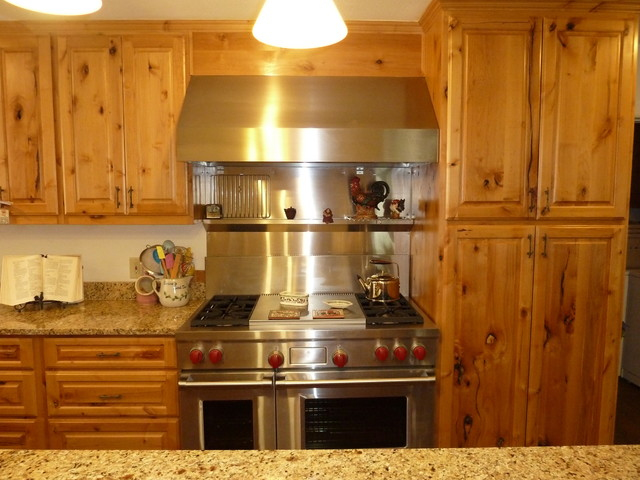 Picture of: eclectic kitchen knotty alder cabinets