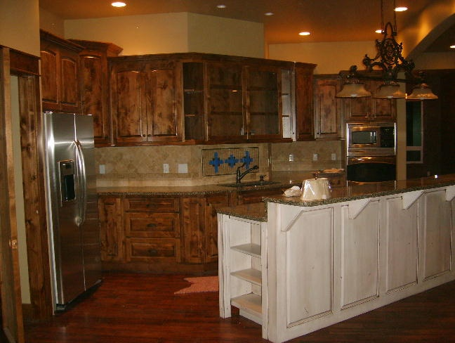 Picture of: knotty alder cabinets eclectic kitchen