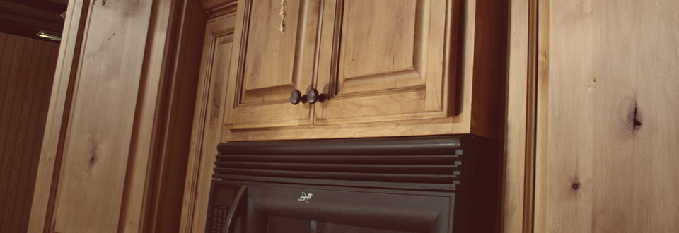 Picture of: knotty alder cabinets picture