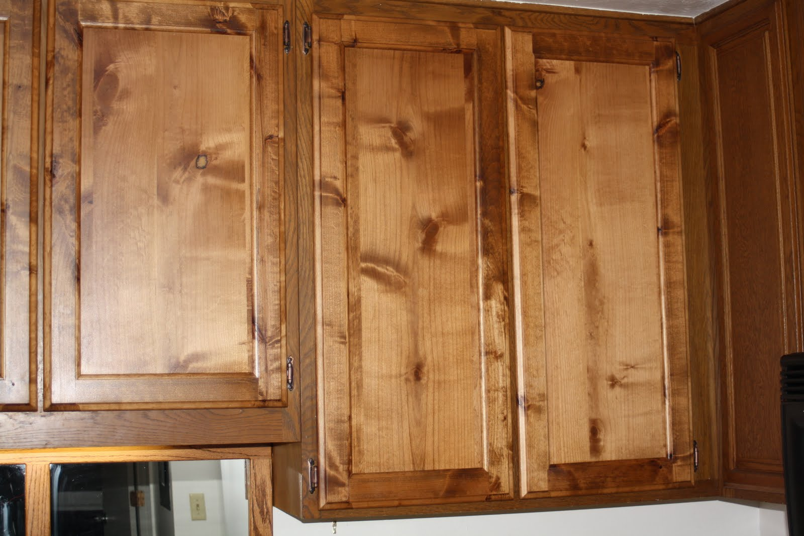 Picture of: knotty alder cabinets pictures