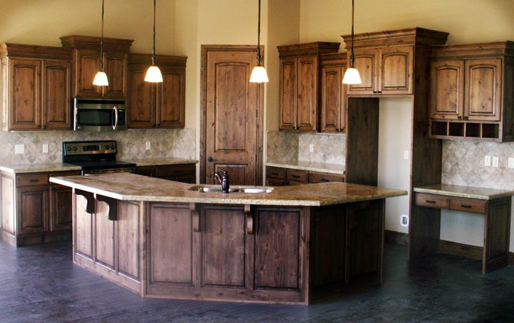 Picture of: knotty alder cabinets with table design