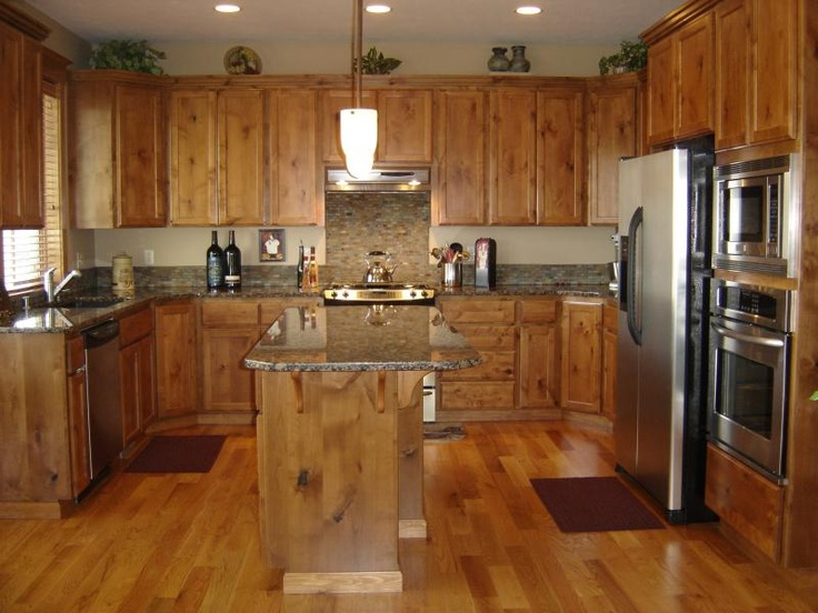 Picture of: light knotty alder cabinets