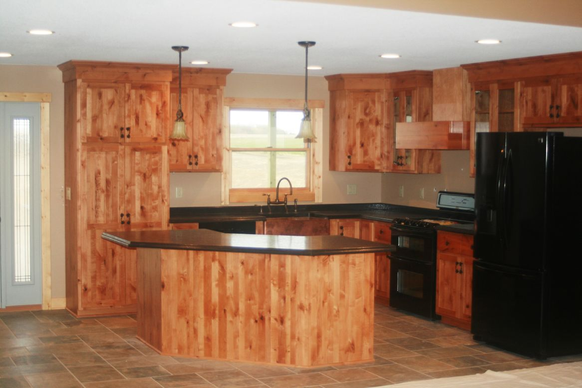 Picture of: resized knotty alder cabinets