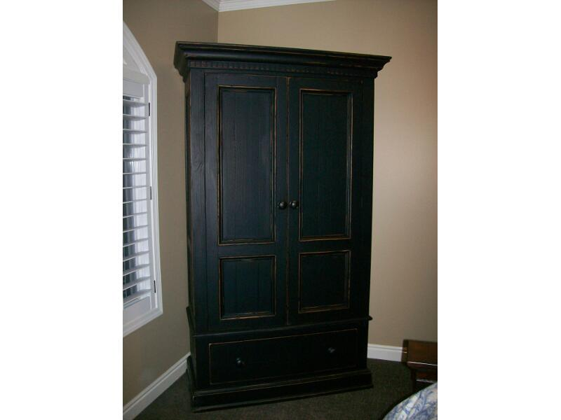 Image of: Black distressed armoire