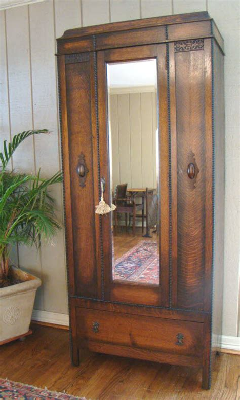 Picture of: Rustic Mirrored Armoire Wardrobe