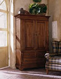 Picture of: Simple Wood Armoire Wardrobe