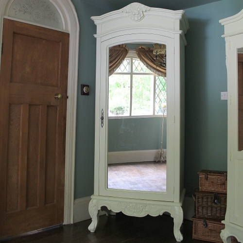 Picture of: Wide Mirrored Armoire Wardrobe