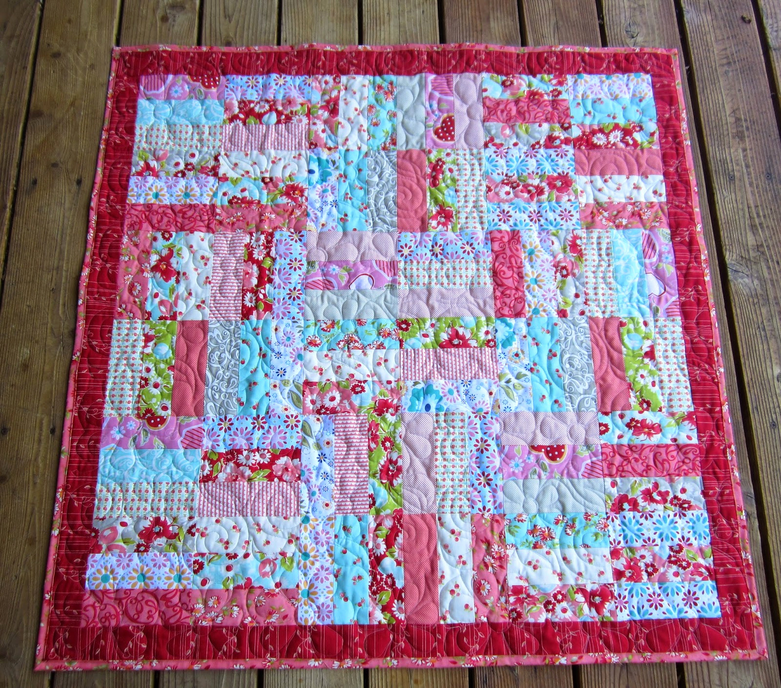 Image of: Jelly Roll Baby Quilt in Pink